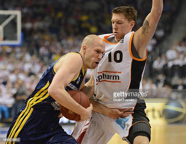 Zach Morley of Berlin is challenged by Daniel Theis of Ulm during the Beko BBLTop Four final game between Ratiopharm Ulm and Alba Berlin at O2 World...
