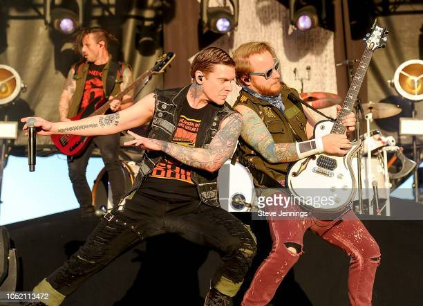 Zach Myers Brent Smith and Eric Bass of Shinedown perform on Day 1 of the 2018 Aftershock Festival at Discovery Park on October 13 2018 in Sacramento...