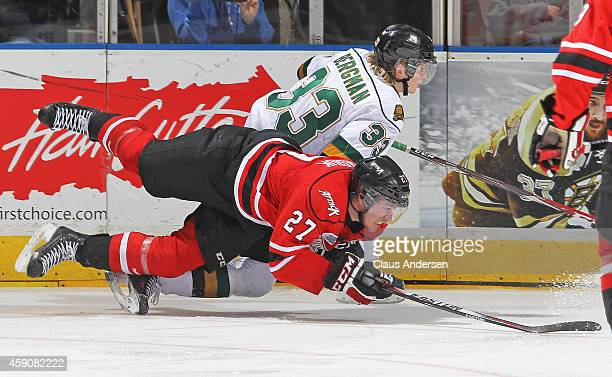 Zach Nastasiuk of the Owen Sound Attack battles against Julius Bergman of the London Knights in an OHL game at Budweiser Gardens on November 14 2014...
