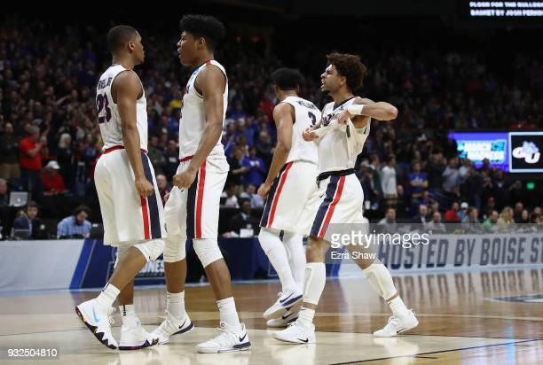Zach Norvell Jr #23 of the Gonzaga Bulldogs celebrates with teammates after making a three point basket in the second half against the UNCGreensboro...