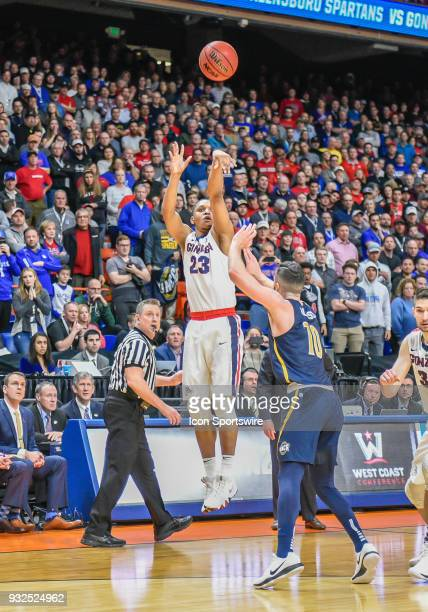 Zach Norvell Jr of the Gonzaga Bulldogs shoots a three pointer over G Francis Alonso of the North CarolinaGreensboro Spartans with 21 seconds left on...
