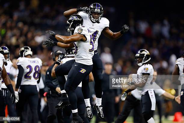 Zach Orr and Albert McClellan of the Baltimore Ravens react to a defensive stop during the second quarter of a game against the New Orleans Saintsat...