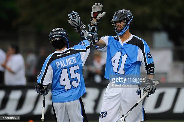 Zach Palmer of the Ohio Machine congrats teammate Kevin Cooper after a goal against the Charalotte Hounds in the second quarter at Selby Stadium on...