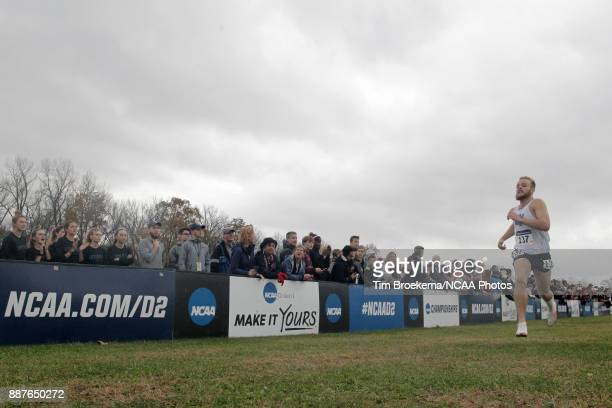 Zach Panning of Grand Valley State University runs to the finish line during the Division II Men's Cross Country Championship held at the Angel...