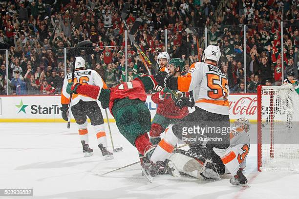 Zach Parise and Jason Zucker of the Minnesota Wild celebrate after scoring a goal against Nick Schultz and goalie Steve Mason of the Philadelphia...