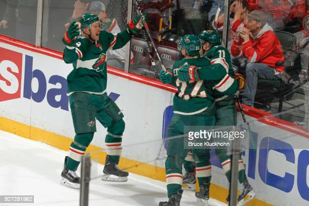 Zach Parise celebrates his goal with teammates Nate Prosser and Nino Niederreiter of the Minnesota Wild against the Detroit Red Wings during the game...