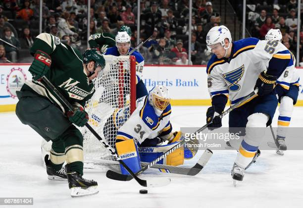 Zach Parise of the Minnesota Wild and Colton Parayko of the St Louis Blues go after a rebound as Blues goalie Jake Allen looks on during the second...