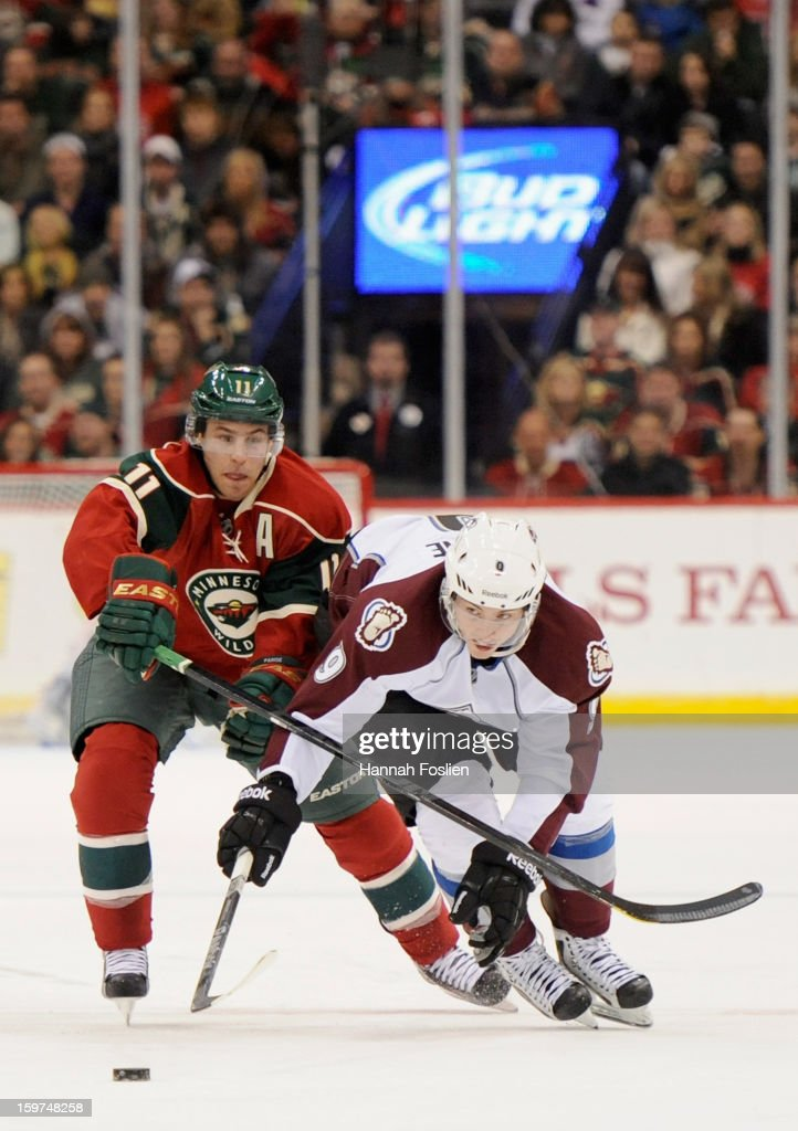 Zach Parise #11 of the Minnesota Wild and Matt Duchene #9 of the Colorado Avalanche go after the puck during the third period of the season opener on January 19, 2013 at Xcel Energy Center in St. Paul, Minnesota. The Wild defeated the Avalanche 4-2.