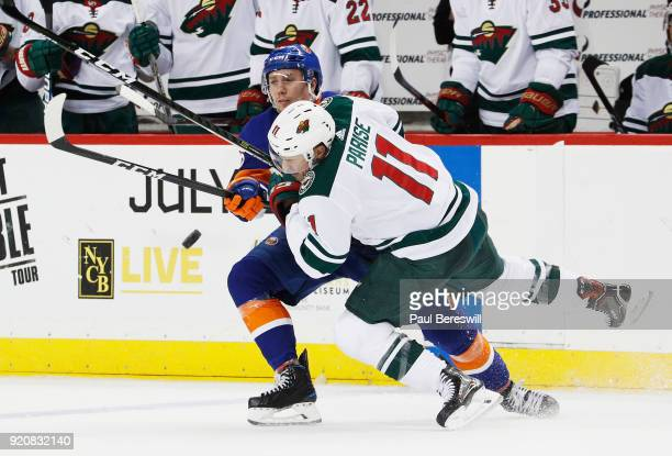 Zach Parise of the Minnesota Wild and Tanner Fritz of the New York Islanders battle during the third period at Barclays Center on February 19 2018 in...