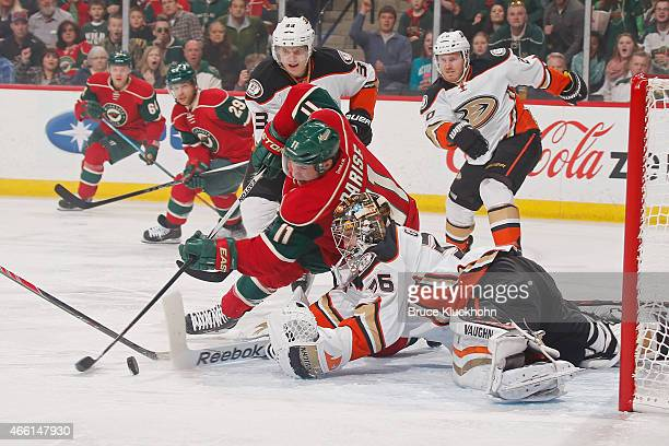 Zach Parise of the Minnesota Wild attempts to score with Jakob Silfverberg and goalie John Gibson of the Anaheim Ducks defending during the game on...
