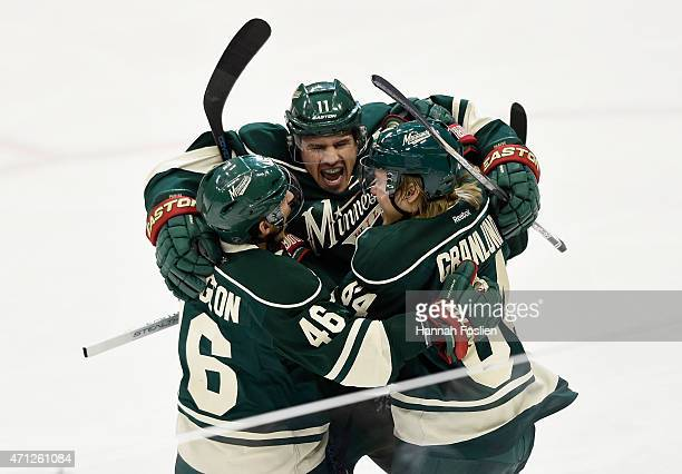 Zach Parise of the Minnesota Wild celebrates scoring a shorthanded goal against the St Louis Blues with teammate Jared Spurgeon and Mikael Granlund...