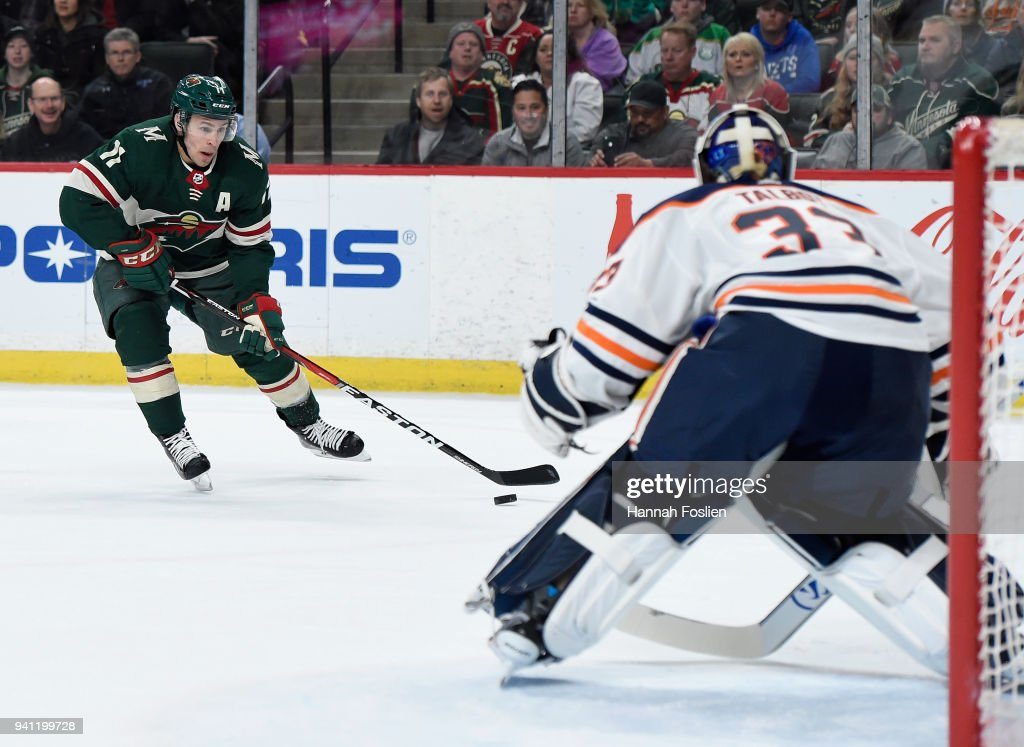 Zach Parise #11 of the Minnesota Wild controls the puck as Cam Talbot #33 of the Edmonton Oilers defends the net during the first period of the game on April 2, 2018 at Xcel Energy Center in St Paul, Minnesota. The Wild defeated the Oilers 3-0.