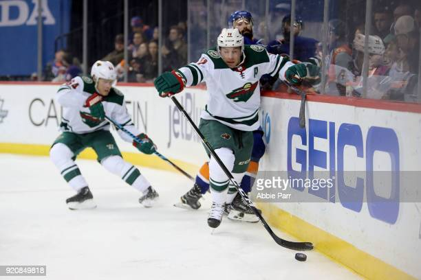 Zach Parise of the Minnesota Wild fights for the puck against Nick Leddy of the New York Islanders in the third period during their game at Barclays...