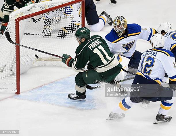 Zach Parise of the Minnesota Wild scores a goal against Brian Elliott of the St Louis Blues during the third period in Game Six of the Western...