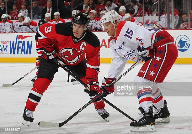 Zach Parise of the New Jersey Devils and Jeff Halpern of the Washington Capitals set themselves for a faceoff during the game at the Prudential...