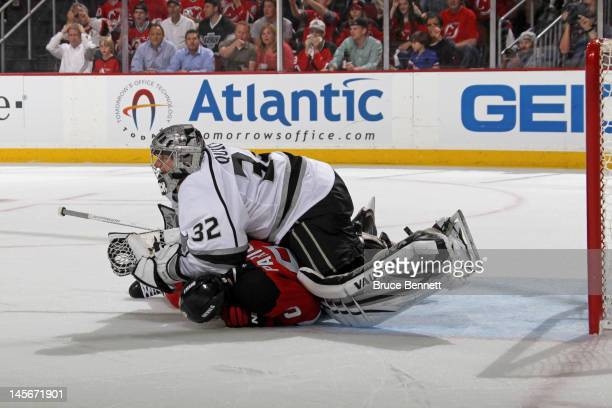 Zach Parise of the New Jersey Devils collides with Jonathan Quick of the Los Angeles Kings during Game One of the 2012 NHL Stanley Cup Final at the...