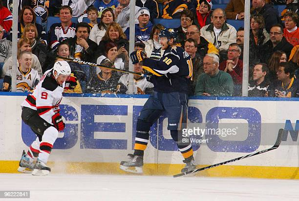 Zach Parise of the New Jersey Devils loses his stick after being checked by Henrik Tallinder of the Buffalo Sabres on January 27, 2010 at HSBC Arena...