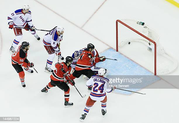 Zach Parise of the New Jersey Devils scores a third period goal past Henrik Lundqvist of the New York Rangers in Game Four of the Eastern Conference...