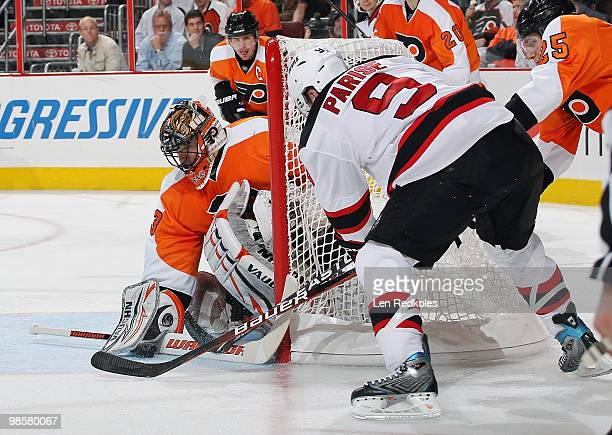 Zach Parise of the New Jersey Devils tries to stuff the puck past goaltender Brian Boucher of the Philadelphia Flyers in Game Four of the Eastern...