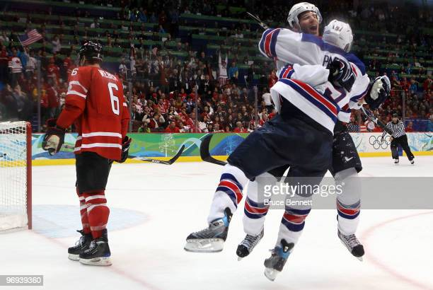 Zach Parise of the United States and Ryan Kesler of the United States celebrate after Kesler scored an empty net goal in the third period during the...