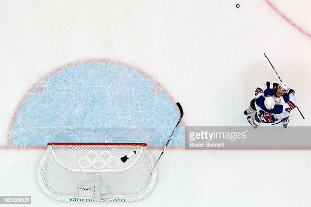 Zach Parise of the United States and Ryan Kesler of the United States celebrate after Kesler scored during the ice hockey men's preliminary game...