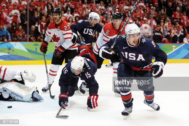 Zach Parise of the United States celebrates after scoring a goal to tie the scores 22 late in the third during the ice hockey men's gold medal game...