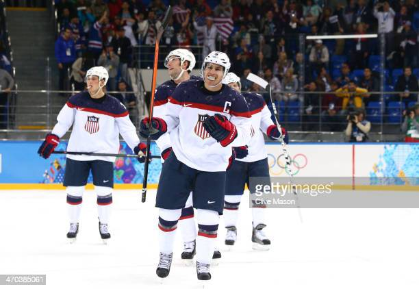 Zach Parise of the United States celebrates after scoring his team's fourth goal in the second period against Ondrej Pavelec of the Czech Republic...