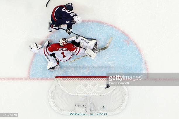 Zach Parise of the United States shoots the puck past Roberto Luongo of Canada late in third period during the ice hockey men's gold medal game...