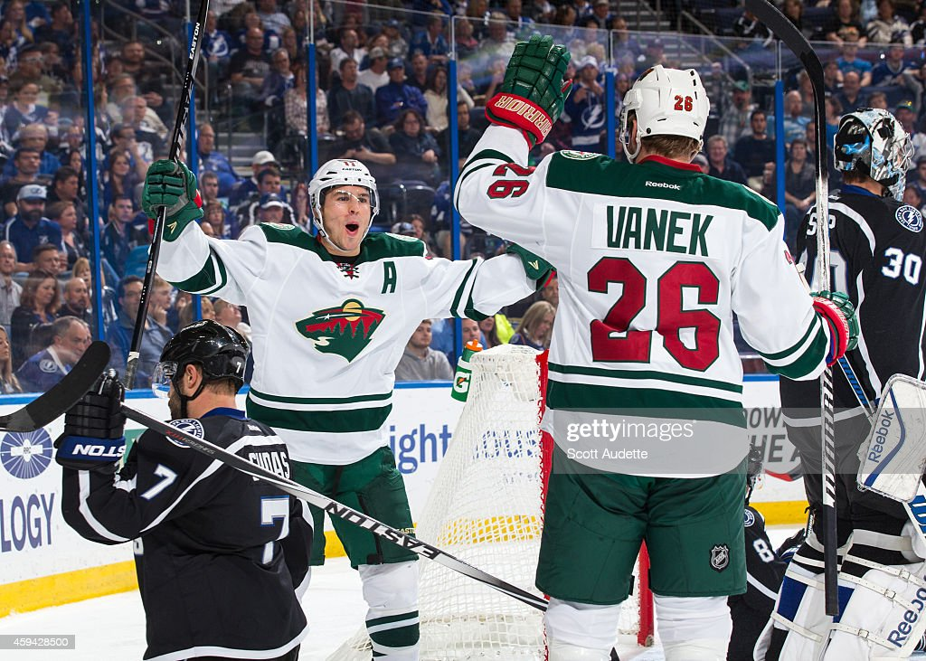 Zach Parise #11of the Minnesota Wild celebrates his goal with teammate Thomas Vanek #26 during the second period against Radko Gudas #7 and goalie Ben Bishop #30 at the Amalie Arena on November 22, 2014 in Tampa, Florida.