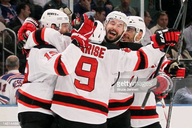 Zach Parise Travis Zajac Ilya Kovalchuk and Bryce Salvador of the New Jersey Devils celebrate their 5 to3 win over the New York Rangers in Game Five...