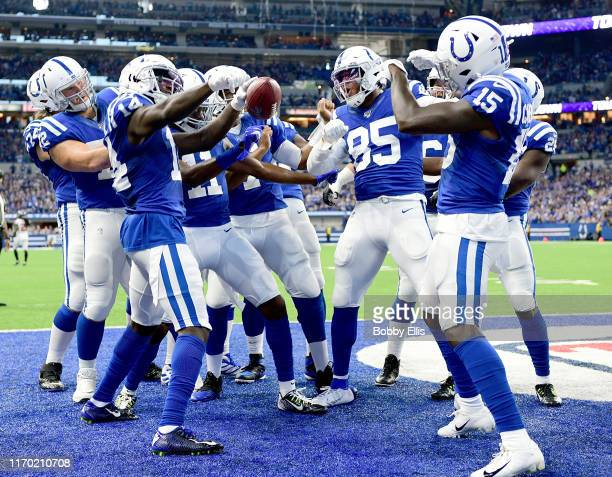 Zach Pascal of the Indianapolis Colts and other members of the Indianapolis Colts celebrate after a touchdown in the first quarter of the game...