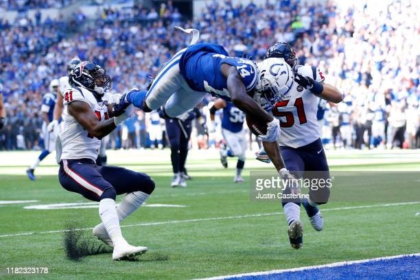 Zach Pascal of the Indianapolis Colts dives for a touch down during the first quarter in the game against the Houston Texans at Lucas Oil Stadium on...