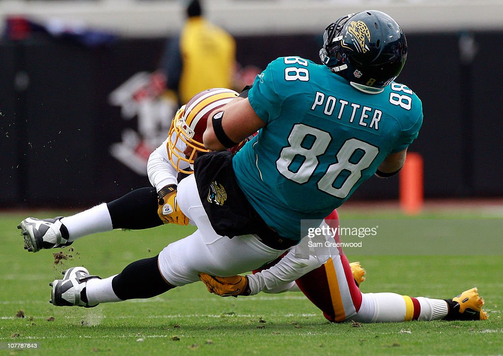 Zach Potter #88 of the Jacksonville Jaguars is tackled by Carlos Rogers #22 of the Washington Redskins during the game at EverBank Field on December 26, 2010 in Jacksonville, Florida.