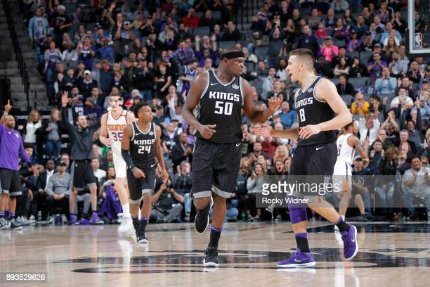 Zach Randolph and Bogdan Bogdanovic of the Sacramento Kings react during the game against the Phoenix Suns on December 12 2017 at Golden 1 Center in...