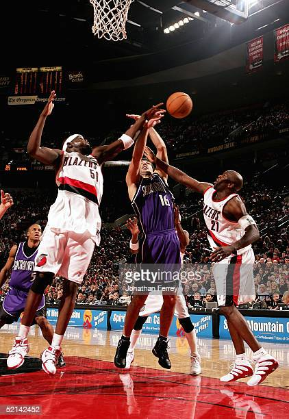 Zach Randolph and Ruben Patterson of the Portland Trail Blazers guard against Peja Stojakovic of the Sacramento Kings on February 5 2005 at the Rose...