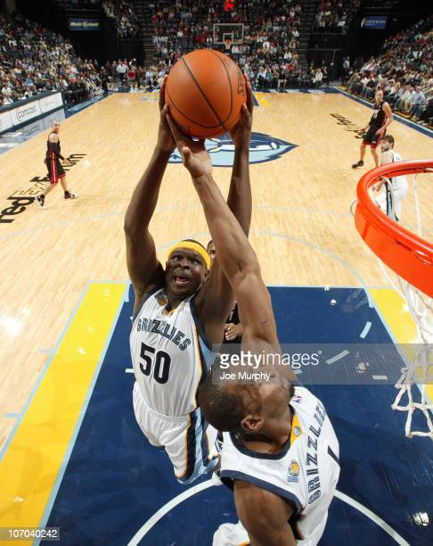 Zach Randolph and Sam Young of the Memphis Grizzlies rebound against the Miami Heat on November 20 2010 at FedExForum in Memphis Tennessee NOTE TO...