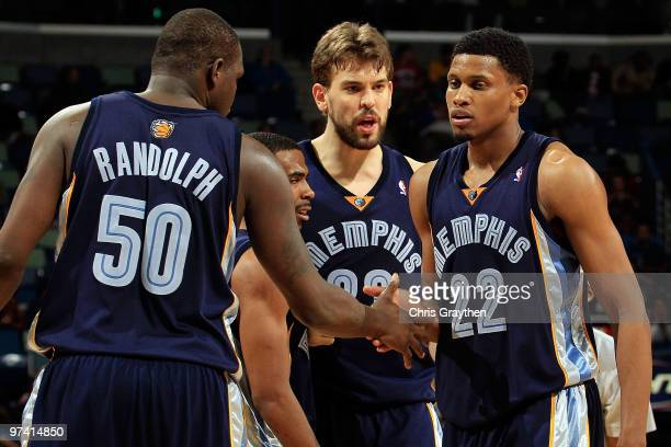 Zach Randolph, Mike Conley, Marc Gasol congratulate Rudy Gay of the Memphis Grizzlies after picking up a loose ball against the New Orleans Hornets...