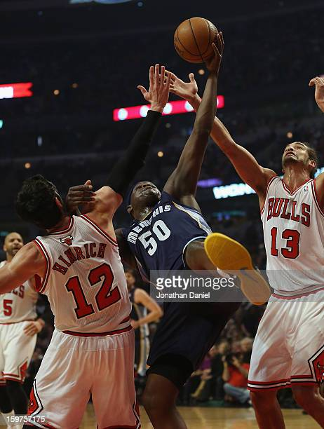 Zach Randolph of the Memphis Grizzles tries to rebound between Kirk Hinrich and Joakim Noah of the Chicago Bulls at the United Center on January 19...