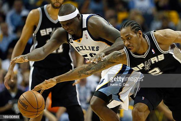 Zach Randolph of the Memphis Grizzlies and Kawhi Leonard of the San Antonio Spurs go after a loose ball in the first half during Game Three of the...