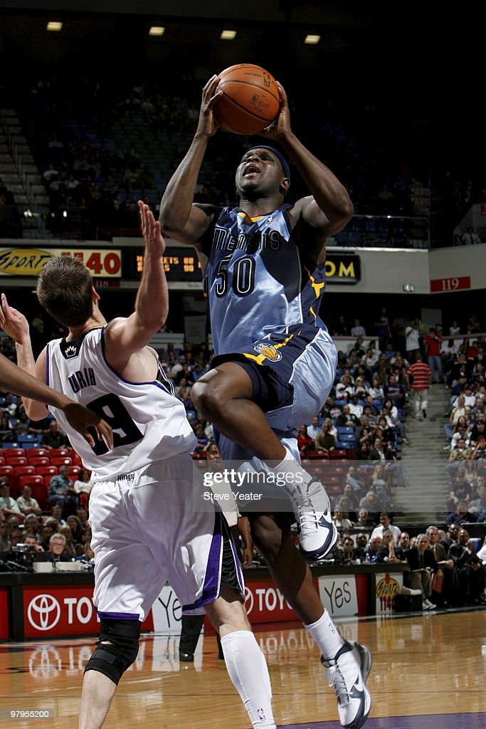 Zach Randolph #50 of the Memphis Grizzlies gets to the basket against Beno Udrih #19 of the Sacramento Kings on March 22, 2010 at ARCO Arena in Sacramento, California.