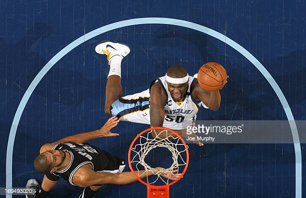 Zach Randolph of the Memphis Grizzlies goes to the basket against Tim Duncan of the San Antonio Spurs during Game Three of the Western Conference...