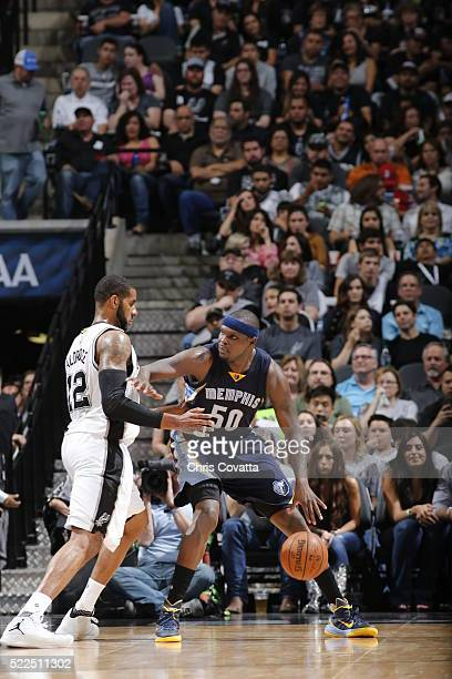 Zach Randolph of the Memphis Grizzlies handles the ball against Tim Duncan of the San Antonio Spurs in Game Two of the Western Conference...