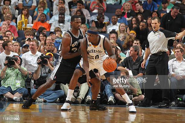 Zach Randolph of the Memphis Grizzlies posts up against Antonio McDyess of the San Antonio Spurs in Game Three of the Western Conference...