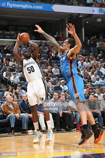Zach Randolph of the Memphis Grizzlies shoots against Steven Adams of the Oklahoma City Thunder during the game on December 8 2015 at FedExForum in...