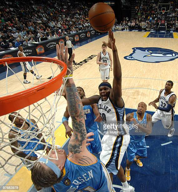 Zach Randolph of the Memphis Grizzlies shoots over Chris Andersen of the Denver Nuggets on March 13 2010 at FedExForum in Memphis Tennessee NOTE TO...