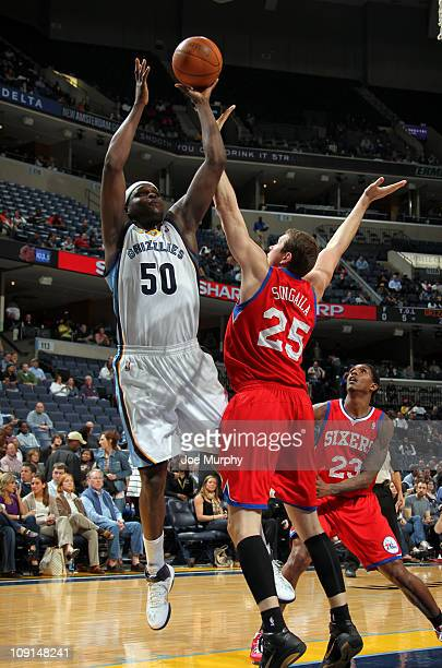 Zach Randolph of the Memphis Grizzlies shoots over Darius Songaila of the Philadelphia 76ers on February 15 2011 at FedExForum in Memphis Tennessee...
