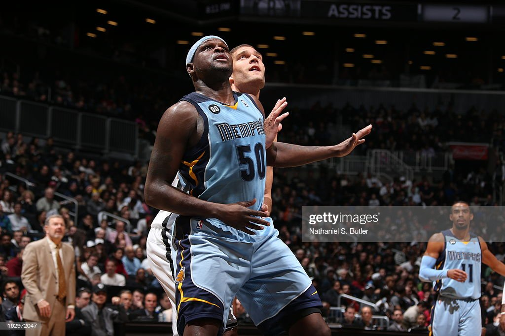 Zach Randolph #50 of the Memphis Grizzlies waist for a rebound against Brook Lopez #11 of the Brooklyn Nets on February 24, 2013 at the Barclays Center in the Brooklyn borough of New York City.