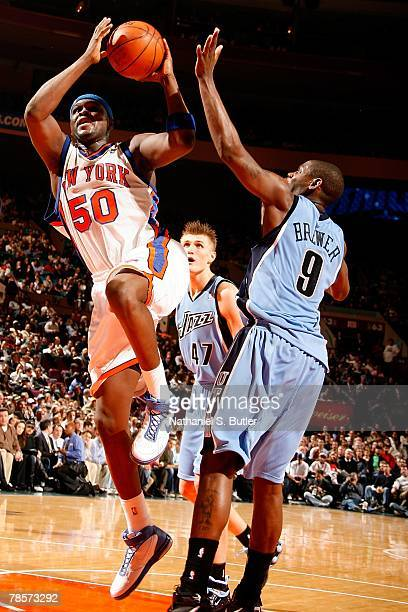 Zach Randolph of the New York Knicks goes up for a shot over Ronnie Brewer and Andrei Kirilenko of the Utah Jazz during the game on November 26 2007...
