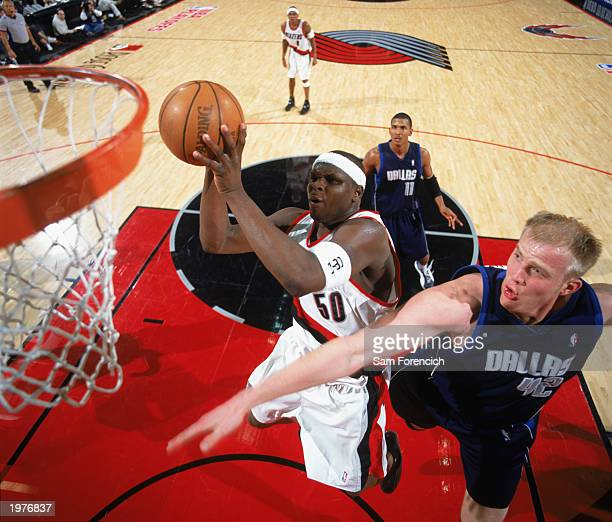 Zach Randolph of the Portland Trail Blazers contests the defense of Evan Eschmeyer of the Dallas Mavericks in Game Four of the Western Conference...