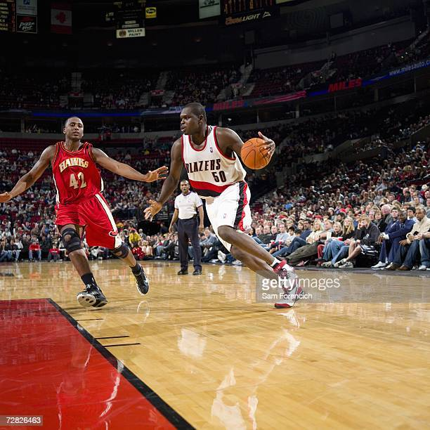 Zach Randolph of the Portland Trail Blazers drives against Lorenzen Wright of the Atlanta Hawks during a game at Rose Garden on December 3 2006 in...